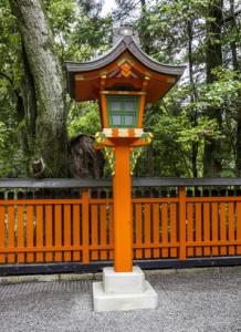Ornamental orange wooden lantern at a japanese shinto shrine