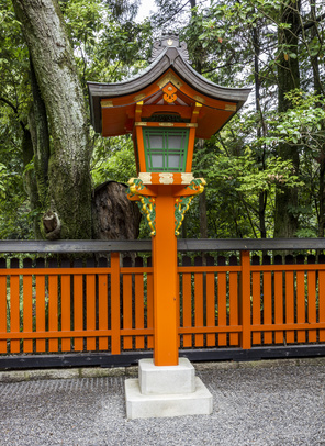 Ornamental orange wooden lantern at a japanese shinto shrine